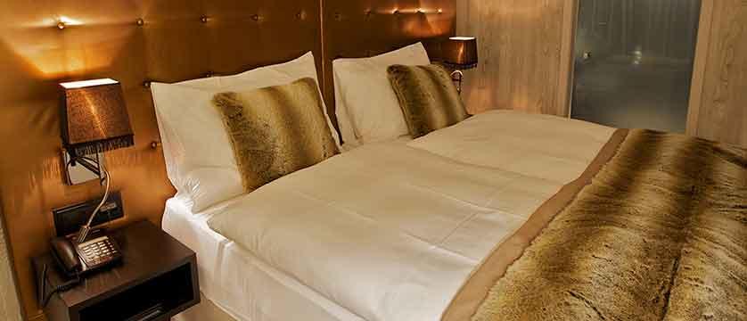 Hotel Grischa, Davos, Graubünden, Switzerland - double bedroom interior.jpg